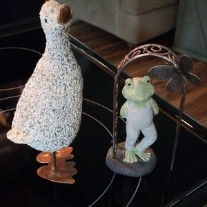Goose and frog figurines
